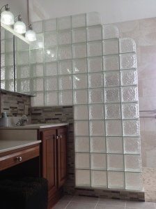 Curbless Icescapes glass block shower with a step-down design